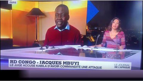 Le Juge Jacques Mbuyi au micro de Caroline Dumay